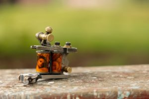 Coil Tattoo Machine Reviews and Guide photo by Benjamin Lehman on Unplash